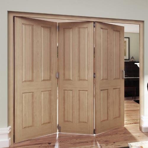 Oregon 4 panel oak doors in a roomfold setting